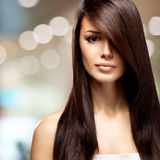 Woman with long straight brown hair Stock Photo