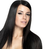 Woman with long straight hair. Fashion model posing at studio Stock Image