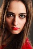 Woman long straight hair dark makeup red lips on gray Stock Image