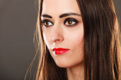 Woman long straight hair dark makeup red lips on gray Royalty Free Stock Photography