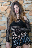 Woman with long straight hair wearing mesh shirt black bra and jean shorts Royalty Free Stock Photo
