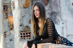 Woman with long straight hair wearing mesh shirt black bra and jean shorts Royalty Free Stock Photos