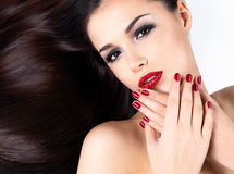 Woman with long straight hairs and elegance nails. Beautiful woman with long brown straight hairs and elegance red nails stock photo
