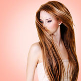 Woman with long straight hairs. Over pink background royalty free stock photos
