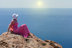 Woman in a long summer dress in Greece, Santorini. Royalty Free Stock Photos