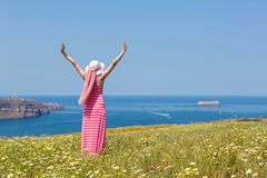 Woman in a long summer dress standing in a field of daisies Royalty Free Stock Photo