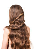 Woman with long wavy brown hair isolated on white background. royalty free stock photography