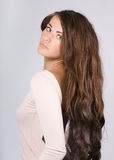 Woman with long wavy hair. Royalty Free Stock Image