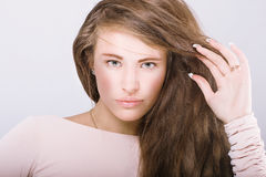 Woman with long wavy hair. Royalty Free Stock Images