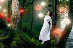 Woman in long white  dress Stock Photography