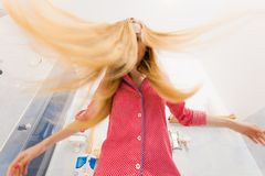 Woman with long windblown blonde hair Stock Photography