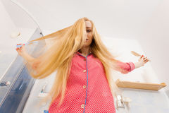 Woman with long windblown blonde hair Stock Images
