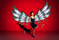 Woman with long wings. Art photo of woman with long wings Royalty Free Stock Photography