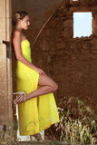 Woman in long yellow dress Stock Photo