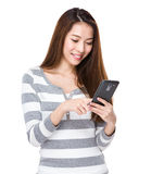 Woman look at the cellphone Royalty Free Stock Image