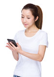 Woman look at cellphone Royalty Free Stock Images