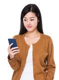 Woman look at cellphone Royalty Free Stock Photos