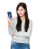 Woman look at cellphone Royalty Free Stock Image