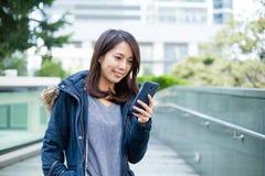 Woman look at cellphone Stock Photos
