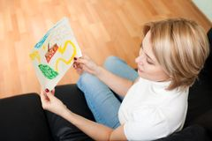Woman look at child painting Stock Photo
