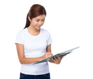 Woman look at clipboard Stock Photos
