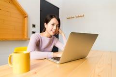 Woman look at computer at home Royalty Free Stock Image