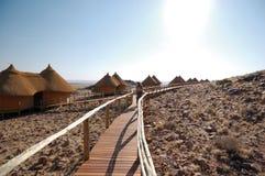Woman look at the desert. Woman on the wood bridge look at the desert - Safari Lodge stock photos