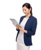 Woman look at digital tablet Royalty Free Stock Photos