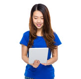 Woman look at digital tablet Stock Images