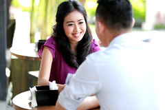 Woman look happy talking with her boyfriend Stock Images