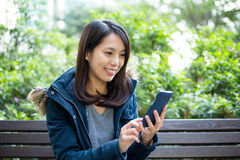 Woman look at mobile phone Stock Images
