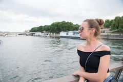 Woman look at seine river in paris, france. Sensual woman in sunglasses on bridge on summer day. Vacation and wanderlust concept.  Stock Photo
