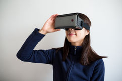 Woman look though virtual reality device Royalty Free Stock Photo