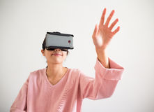 Woman look though vr device and hand want to touch something Stock Photos