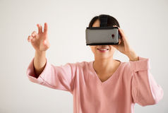 Woman look though vr device Stock Photos