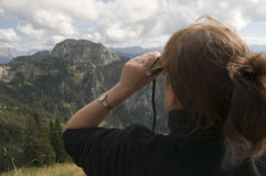 Woman look to the alps Stock Image