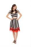 Woman look up thinking. Standing woman in black and white stripes dress look up while thinking Stock Photo