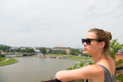 Woman look at vistula river in krakow, poland. Sensual woman in sunglasses on sunny day. Summer vacation concept. Wanderlust, trav Royalty Free Stock Images