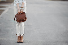 Woman look of white with red leather handbag and boats. Royalty Free Stock Images