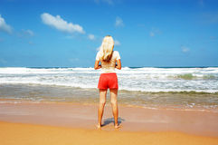 Woman is lookin on the ocean Royalty Free Stock Photography