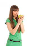 Woman looking at an apple. Royalty Free Stock Photo