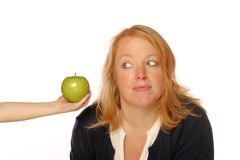 Woman looking at an apple Stock Image