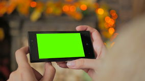 Free Woman Looking At Smartphone With Green Screen Stock Photo - 83932620