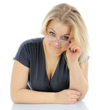 The woman looking atop of glasses Royalty Free Stock Photography