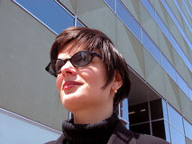 Woman looking away. Businesswoman looking away near an office building-natural lighting Royalty Free Stock Photography