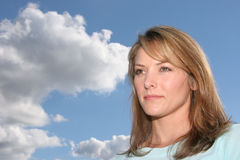 Woman looking away. Woman and blue sky stock photo