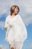 Woman looking away against blue sky and clouds Royalty Free Stock Photos