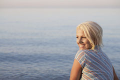 Woman Looking Away Against Sea At Beach Royalty Free Stock Photography