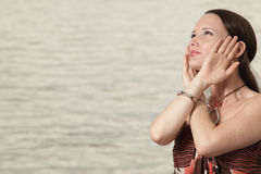 Woman looking away and caressing her head Stock Photo