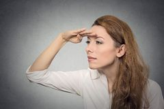 Woman looking away into the future. Business woman looking away into the future monitoring isolated on grey wall background. Human face expressions, emotions Stock Images
